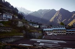 Airplane staying on the airfield of Lukla royalty free stock image