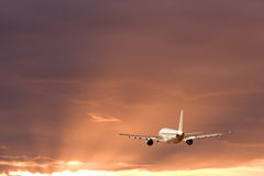 Airplane in stormy sky Royalty Free Stock Photo