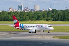 Airplane Sukhoi Superjet 100 RA-89087 of Yamal Airlines on the taxiway on the Pulkovo Airport stock photos
