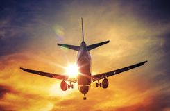 Airplane and the Sun Stock Photo