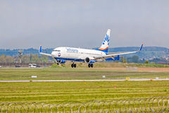 Airplane from SunExpress on landing approach, airport Stuttgart, Germany Royalty Free Stock Image