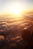 Airplane sunrise. View from the airplane with sunrise and cloud Stock Images