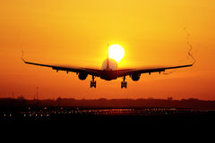 Airplane sunrise landing Stock Image