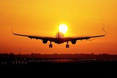 Airplane sunrise landing Stock Image