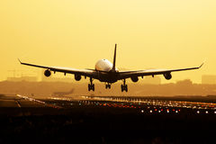 Airplane sunrise landing Royalty Free Stock Image