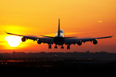 Airplane sunrise landing Stock Photography