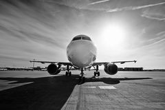 Airplane at the sunrise Royalty Free Stock Photo