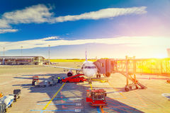 Airplane at sunrise in the terminal gate ready for takeoff - Wai Stock Photography
