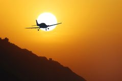 Airplane into the sunset. Airplane returning from the mission Royalty Free Stock Photos
