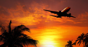 Airplane at sunset. Photo of a Airplane at sunset Stock Images
