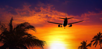 Airplane at sunset Stock Photo