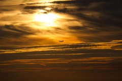 Airplane in sunset Stock Image