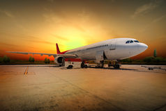 Airplane at sunset Stock Photos