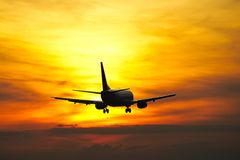 Airplane at the sunset Stock Images