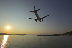 Airplane at sunset Stock Photography