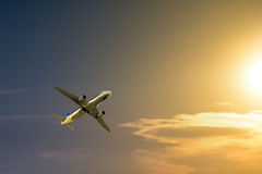 Airplane at sunset Royalty Free Stock Photo