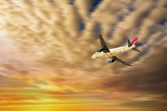 Airplane at sunset Stock Image