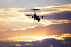 Airplane at the sunset Royalty Free Stock Photo