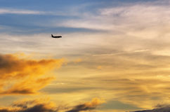 Airplane and  sunset Royalty Free Stock Images