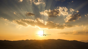 Airplane on sunset Royalty Free Stock Photo