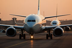 Airplane in sunset Stock Photography