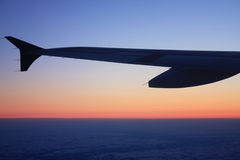 Airplane at sunset Royalty Free Stock Photos