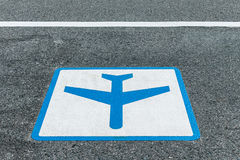 Airplane symbol, sign painted on asphalt road Royalty Free Stock Image