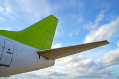 Airplane tail. Blue sky, cloudscape Stock Photos