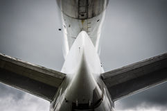 Airplane tail. Seen from underneath, cloudy and rainy weather Stock Images