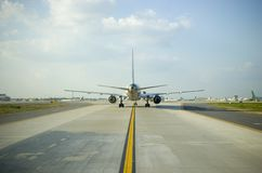 Airplane Tail Wide. Wide angle view of an airliner from the rear during taxi royalty free stock photography