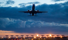 Airplane take of at dusk Royalty Free Stock Image