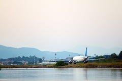 Airplane before take-off, evening scene, Corfu Royalty Free Stock Image