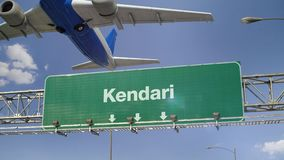 Airplane Take off Kendari. Airplane flying over airport signboard stock video
