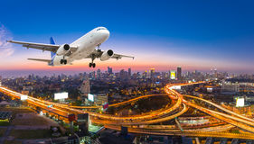 Airplane take off over the panorama city at twilight scene stock image