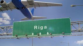 Airplane Take off Riga. Airplane flying over airport signboard stock footage