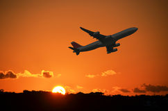 Airplane at take-off. By sunset Royalty Free Stock Image