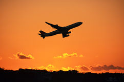 Airplane at take-off. By sunset Royalty Free Stock Photo