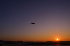 Airplane take off on sunset. Golden sunset at the airport. Twili. Ght sky sunset. Macau Airport Stock Image