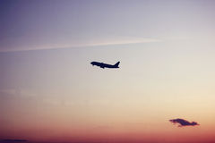 Airplane Take Off at Sunset Royalty Free Stock Photos