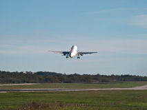 Airplane takeoff. Passenger airplane takeoff - back view royalty free stock images