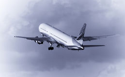 Airplane on takeoff Stock Images