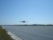 Airplane takeoff. Piston airplane takeoff on clear day Royalty Free Stock Image