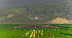 Airplane takeoff o the runway. With green grass around Royalty Free Stock Photography