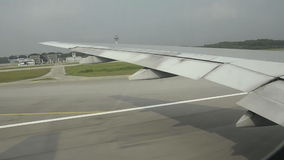 Airplane at takeoff. view trough window with some shaking stock video footage