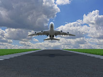 Airplane takes off. Over ground with grass on runway Stock Images