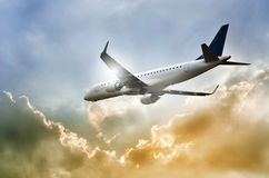 Airplane takes off into dramatic sky Royalty Free Stock Photo