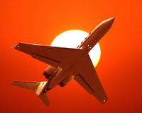 Airplane Taking Off. The airplane flying toward the sun sunrise Stock Photo