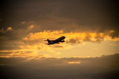 Airplane taking off. With clouds in the sky royalty free stock image
