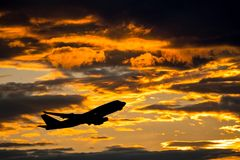 Airplane taking off. With clouds in the sky stock photo