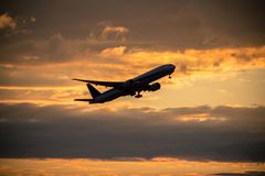Airplane taking off. With clouds in the sky stock image